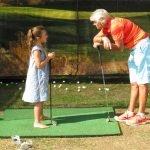 Denise coaching young golfer